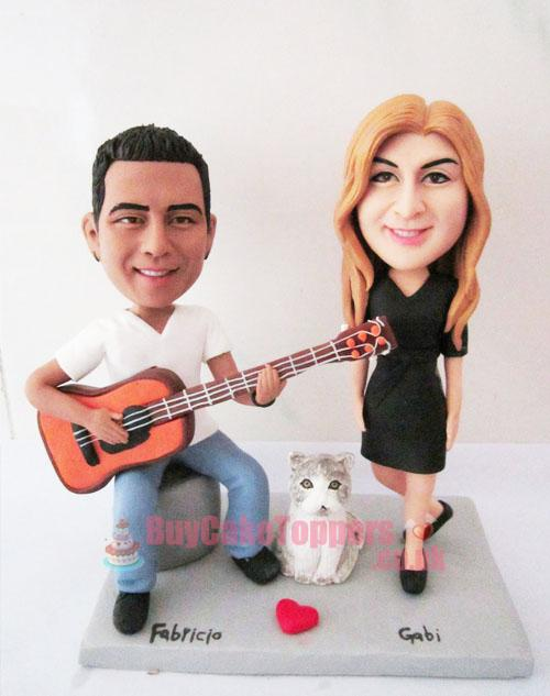 anniversary topper man play guitar