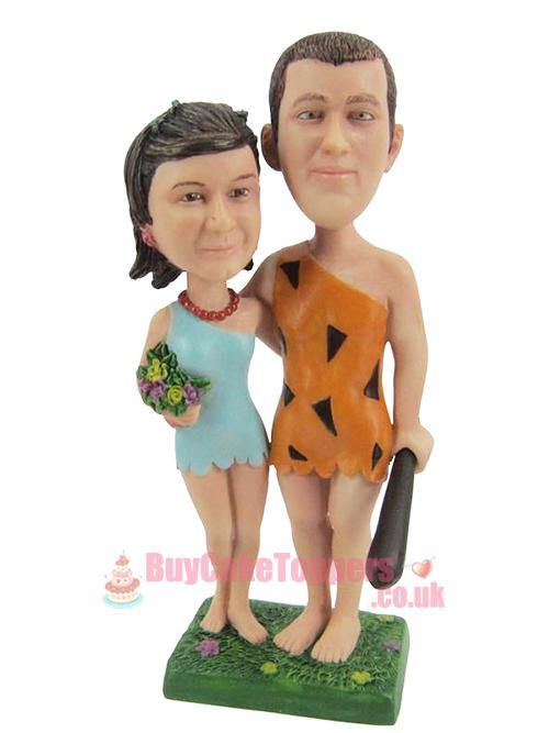 caveman couple wedding topper