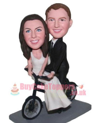 new couple ride a bike cake topper