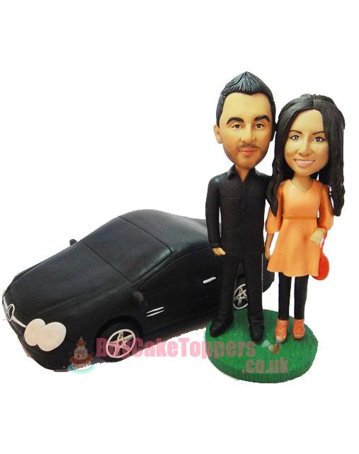 couple with car wedding cake topper