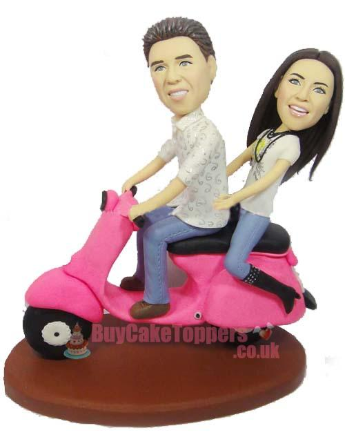 riding scooter wedding cake topper